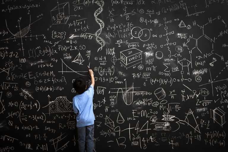 young boy writes math equations on chalkboard 168351254 5ad90020ba61770036501446